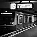 s-bahn train speeding through unter den linden underground station Berlin Germany by Joe Fox