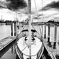 Sailboat Docked by John Rizzuto