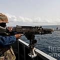 Sailor Fires A M240b Machine Gun Aboard by Stocktrek Images