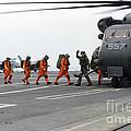 Sailors Board An Mh-53e Sea Dragon by Stocktrek Images