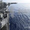 Sailors Fire A 25mm Machine Gun Aboard by Stocktrek Images