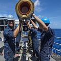 Sailors Load Rim-7 Sea Sparrow Missiles by Stocktrek Images