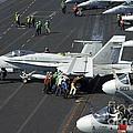 Sailors Push An Fa-18c Hornet by Stocktrek Images