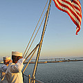 Sailors Salute The National Ensign by Stocktrek Images