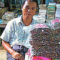 Salesman In The Marketplace In Tachilek-burma by Ruth Hager