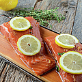 Salmon On A Cutting Board With Lemon by Brandon Bourdages