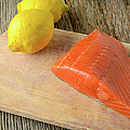 Salmon With Lemons On Wood Background by Brandon Bourdages