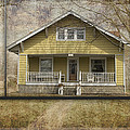Sample Paneled Yellow Bungalow by Thomas Woolworth