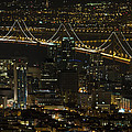 San Francisco Cityscape With Oakland Bay Bridge At Night by David Gn