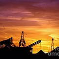 Sand Pit Silhouette  Sunset With Red And Yellow Sky by Robert D  Brozek
