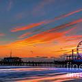 Santa Monica Pier At Dusk by Eddie Yerkish