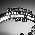 Santa Monica Pier Sign In Black And White by Paul Velgos