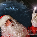 Santa Pointing With Magical Light To The Sky by Sandra Cunningham