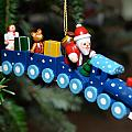 Santa's Train Delivery by Georgette Grossman