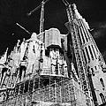 scaffolding and cranes above Sagrada Familia Barcelona Catalonia Spain by Joe Fox