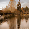Scenic Golden Wooden Bridge Tree Reflection On The Deschutes River by Jerry Cowart