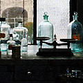 Science - Balance And Bottles In Chem Lab by Susan Savad