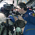 Scientists Onboard Stratotanker by Science Source
