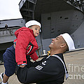 Seaman Greets His Son by Stocktrek Images