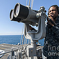 Seaman Stands Lookout Aboard by Stocktrek Images