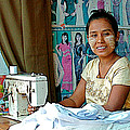 Seamstress At Her Sewing Machine In Tachilek-burma by Ruth Hager