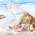 Seashells In A Bottle On The Beach by Sandra Cunningham