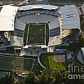 Seattle With Aerial View Of The Newly Renovated Husky Stadium by Jim Corwin