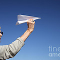 Senior Woman With Paper Plane by Konstantin Sutyagin