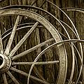 Sepia Photo Of Broken Wagon Wheel And Rims by Randall Nyhof