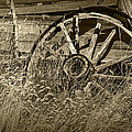 Sepia Toned Photo Of An Old Broken Wheel Of A Farm Wagon by Randall Nyhof
