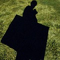 Shadow Carrying Art Portfolio And Drinking A Soda by Renee Trenholm