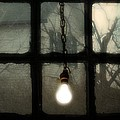 Lit Light Bulb Shines In Old Window by Gothicrow Images