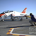 Shooter Signals To The Pilot Of A T-45c by Stocktrek Images