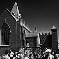 shoppers in market outside St Nicholas collegiate church Galway city county Galway Republic of Irela by Joe Fox