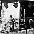 Sidewalk Banjo Plucker In French Quarter by Kathleen K Parker