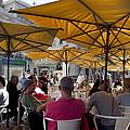 Sidewalk Cafe In Lisbon by Carl Purcell