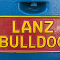 Sign Lanz Bulldog On A Tractor by Matthias Hauser