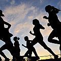 Silhouette Female Runners by Patrick Herrera
