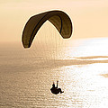 Silhouette Of A Paraglider Flying by Panoramic Images