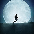 Silhouette Of Girl Running Against Full Moon by Lee Avison