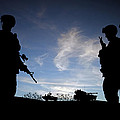 Silhouette Of Modern Soldiers  by Matthew Gibson