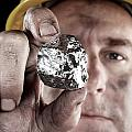 Silver Miner With Nugget by Joe Belanger