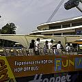Singapore Flyer Along With The Sight-seeing Bus That Takes Tourists Around The City by Ashish Agarwal