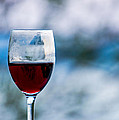 Single Glass Of Red Wine On Blue And White Background by Photographic Arts And Design Studio