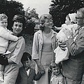 Sir Laurence At The Christening Of His Daughter by Retro Images Archive