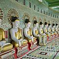 sitting Buddhas in Umin Thonze Pagoda by Juergen Ritterbach