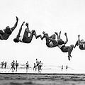 Six Men Doing Beach Flips by Underwood Archives
