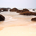 Slow Shutter Sea Around Rocks by Deborah Benbrook