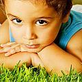 Small Boy On Green Grass by Anna Om