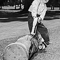 Small Boy Totes Heavy Golf Bag by Underwood Archives